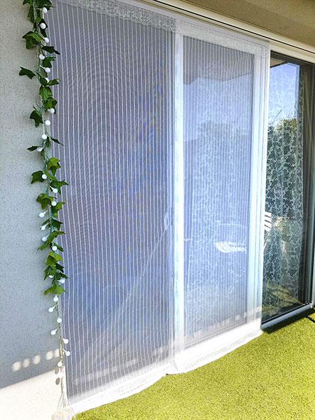 baie vitrée avec moustiquaire de grande taille